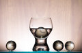 Glass stemware and spheres Royalty Free Stock Photo
