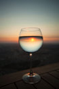 Glass of sun water in the and beautiful sunset Stock Images