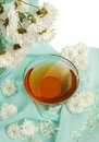 Glass tea cup and flowers Royalty Free Stock Images