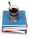 Glass of tea on stack of books above view isolated white background Stock Images