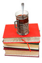 Glass of tea on stack of books retro isolated white background Royalty Free Stock Photo