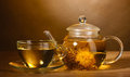 Glass teapot and cup with exotic green tea Stock Photography