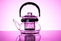 Glass teapot isolated in pink background Stock Image