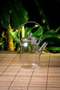 Glass teapot on wooden table Stock Images