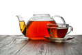 Glass teapot on a wooden table Stock Photos