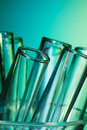 Glass test tubes lighted with blue green light Royalty Free Stock Photo