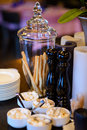 Glass vase with bread snack and decorative candles on the table. Royalty Free Stock Photo