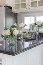 Glass vase of flower on black granite counter Royalty Free Stock Photo
