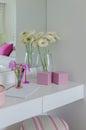 Glass vase of flower on white dressing table Royalty Free Stock Photo