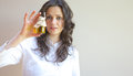 A glass of vegetal oil bottle with in the hand young lady Royalty Free Stock Photos
