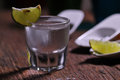Glass of vodka shot with fresh lime Royalty Free Stock Photo
