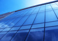 Glass wall of an office building on a sunny day Stock Photography