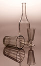 Glass ware on reflective surface bottle wine and Stock Image