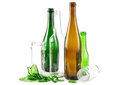 Glass waste with mixed bottles in green white and brown and empty jars Stock Images