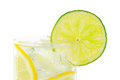 Glass with water clipping path ice cubes and limes against white background Stock Photos