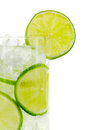 Glass with water clipping path ice cubes and limes against white background Stock Photo