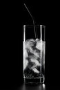 Glass of water and ice on black background Royalty Free Stock Photo
