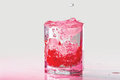 Glass of water, ice and cranberries with splash Royalty Free Stock Photo
