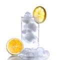 Glass with water, ice cubes and a slice of lemon Stock Photo