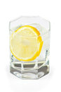 Glass of water, ice and slice of fresh lemon Stock Photography