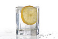 Glass of water, ice and slice of fresh lemon Royalty Free Stock Photo