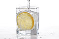 Glass of water, ice and slice of lemon with splash Royalty Free Stock Image