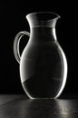 Glass water jug  on the black background Royalty Free Stock Photo