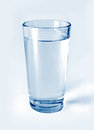 Glass of water on a light background Royalty Free Stock Photos