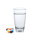 Glass of water with pill capsule Royalty Free Stock Photo