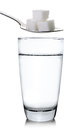 Glass of water and sugar isolated on white background Royalty Free Stock Photo