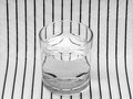 Glass of water symmetry refraction black and white simple or science demonstration maybe Royalty Free Stock Photography