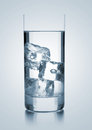 Glass of water with three ice cubes Royalty Free Stock Photo