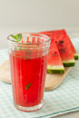 Glass of watermelon juice and fresh fruit Royalty Free Stock Image