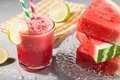 Glass of watermelon juice with ice and watermelon Royalty Free Stock Photo