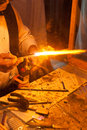 Glass welding welder working on tubes Royalty Free Stock Photo
