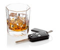 Glass of whiskey and car keys. Stock Images