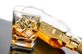 Glass of whiskey near bottle on black table with reflection time relax whisky Stock Photo