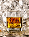 Glass of whiskey poured into the Stock Photos