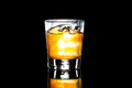 A glass of whiskey on the rock against a dark background Royalty Free Stock Photo