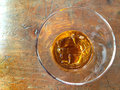 Glass of whiskey on the rocks and ice wooden grunge table Stock Image