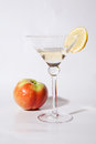 A glass of white wine with apple and lemon Royalty Free Stock Photo