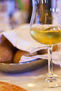 Glass of white wine and fresh bread in restaurant young Stock Images