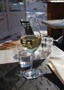 Glass of white wine on the table. Royalty Free Stock Images