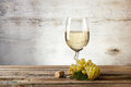 Glass of white wine on vintage wooden table Stock Photography