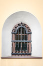Glass window sill behind bars in the form of an arch in a historical building in Lviv, Ukraine Royalty Free Stock Photo