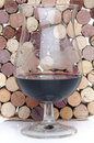 Glass of wine on a background of corks red Stock Photo