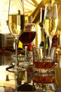 Glass of wine, brandy or cognac on the mirror wooden table Royalty Free Stock Photo