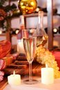 Glass of wine and candle Stock Images