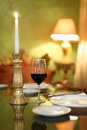 Glass with wine and candle at table Royalty Free Stock Images