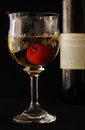 Glass of wine and cherry Royalty Free Stock Photos